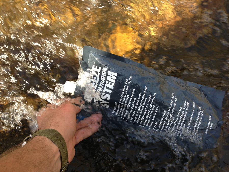 Sawyer Squeeze Filter in Creek